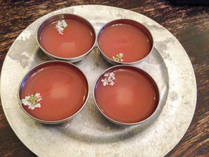 Bowls of seviche juice with a piece of fish hidden inside