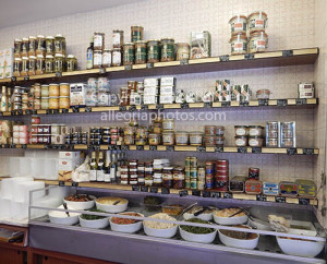 Cans of Pate de Foie Gras line the shelves at Maison Guyard
