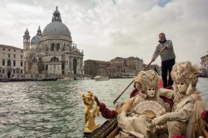 Posing in a gondola near the Basilica of Santa Maria della Salute, Venice.