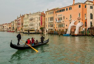 Venetians use traghetti to cross the Grand Canal