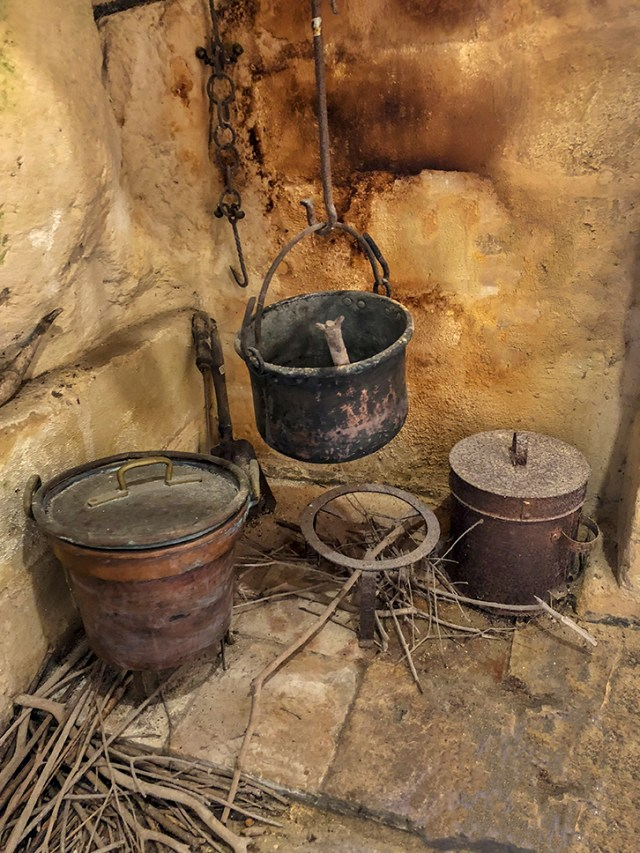 Kitchens in cave dwellings are little more than a pot hanging from a wire over some wood.