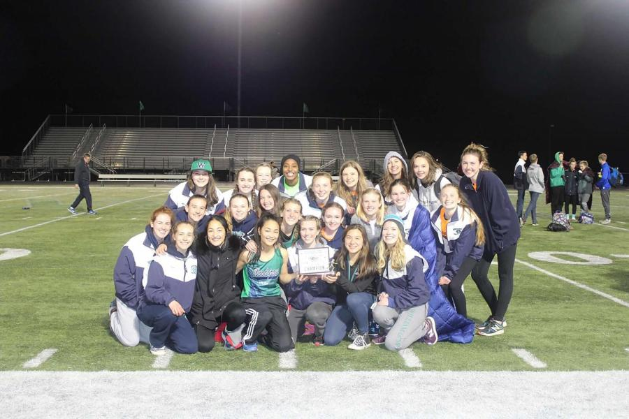 Lady+Wolverines+pose+with+their+first+place+trophy.+