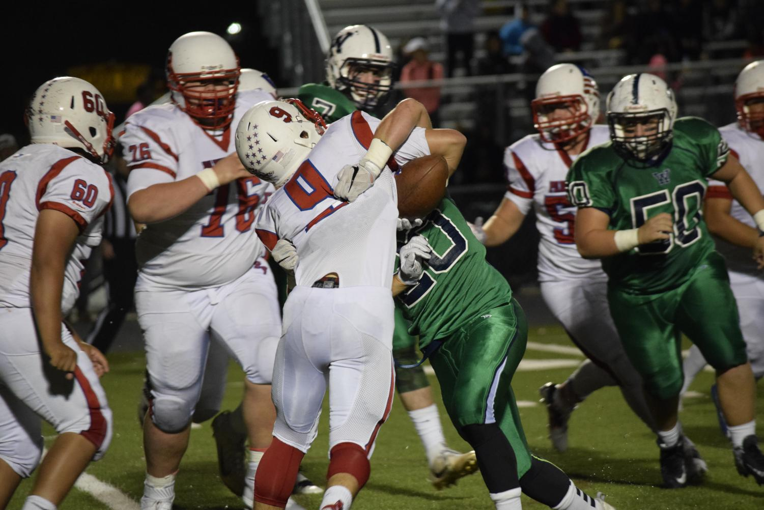 The Park View ball carrier is met by a swarm of Wolverines at the 2016 Park View vs Woodgrove football game.