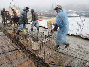 Pouring the cement of the 2nd floor roof