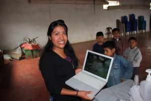 Juana uses computer to track fluoride treatment