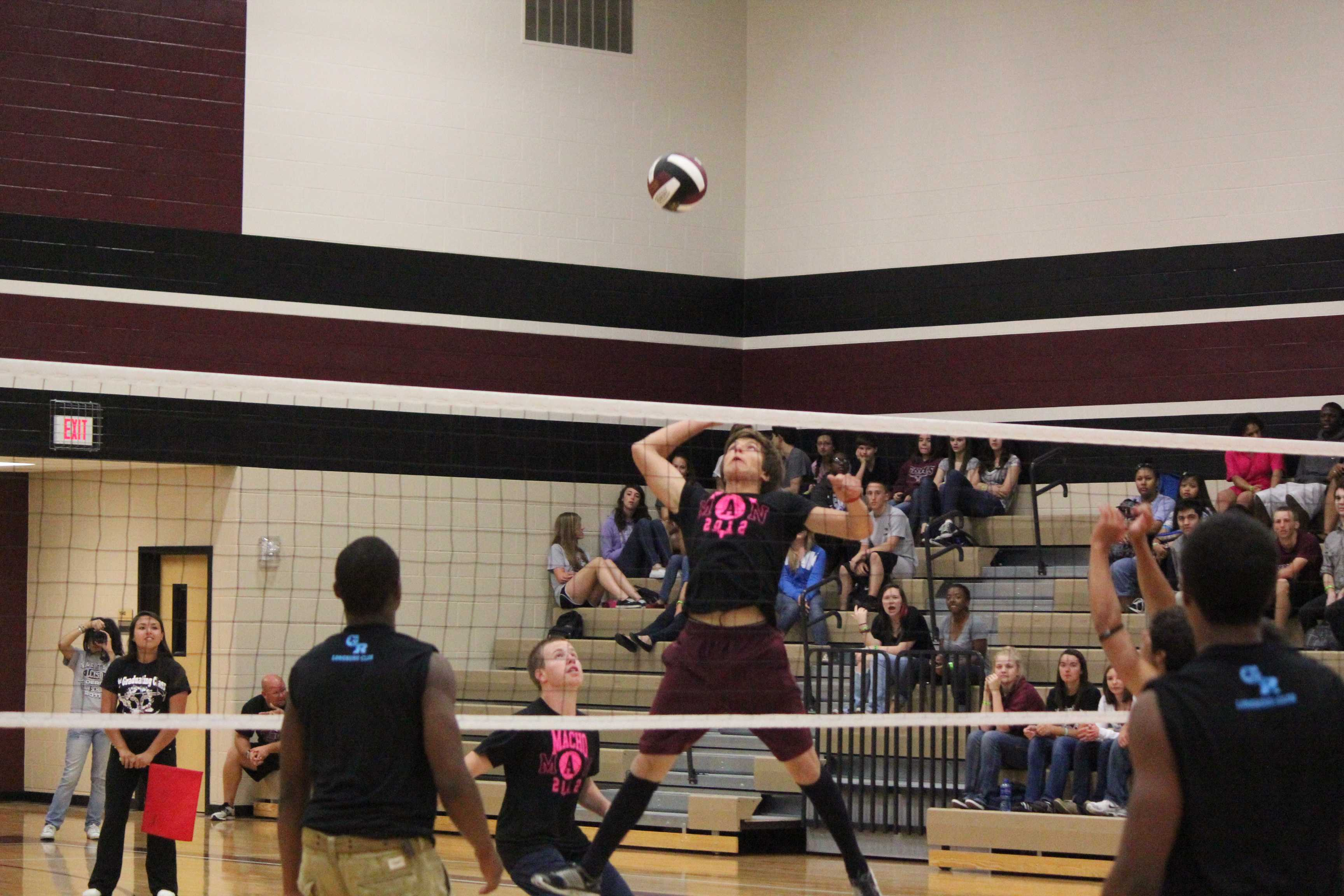 Junior Philip Garza goes for the kill at the Pro-Grad sponsored Macho Man volleyball game.