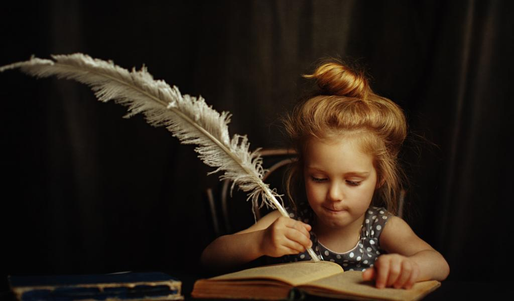 little girl writing with feather