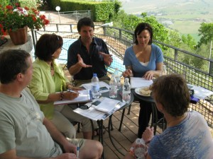 Travel Writing Class on veranda of hotel overlooking Tuscan landscape.