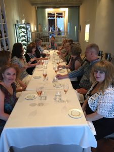 Making a toast during the last supper in Montalcino for the Travel, Food and Wine Writing Class.