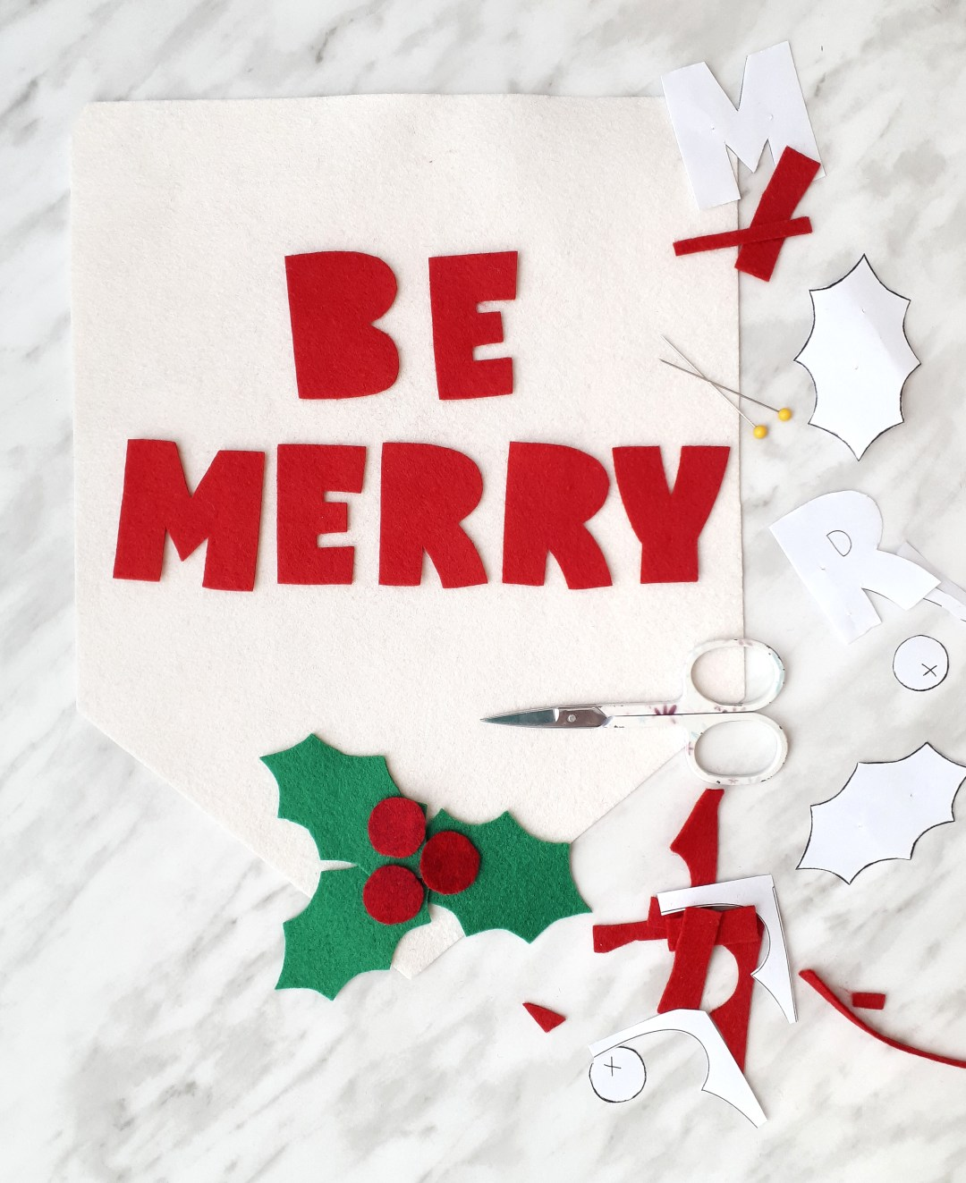 Carefully cut out all the pieces for your DIY Christmas banner