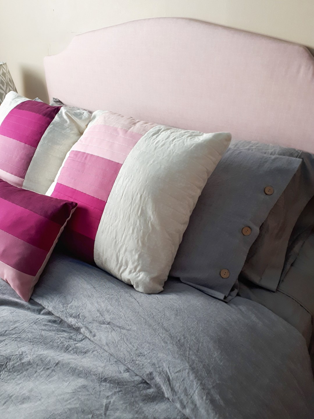 Beautiful new duvet cover and throw cushions for my DIY bedroom update on a budget!