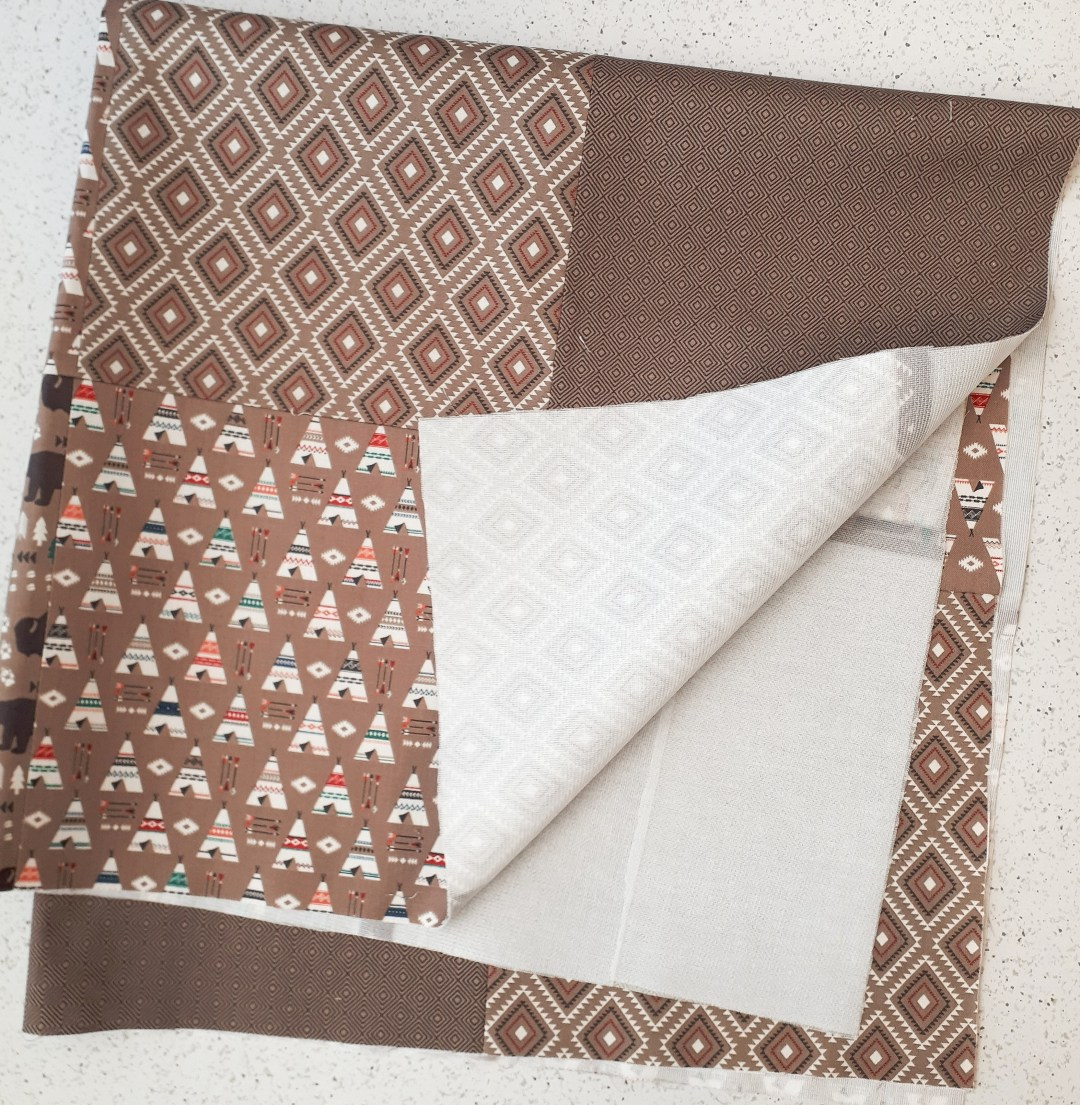 Use lightweight fusible interfacing on your patchwork baby blanket top