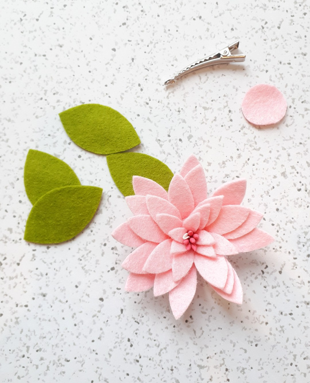 An easy rolled felt flower for making hair clips