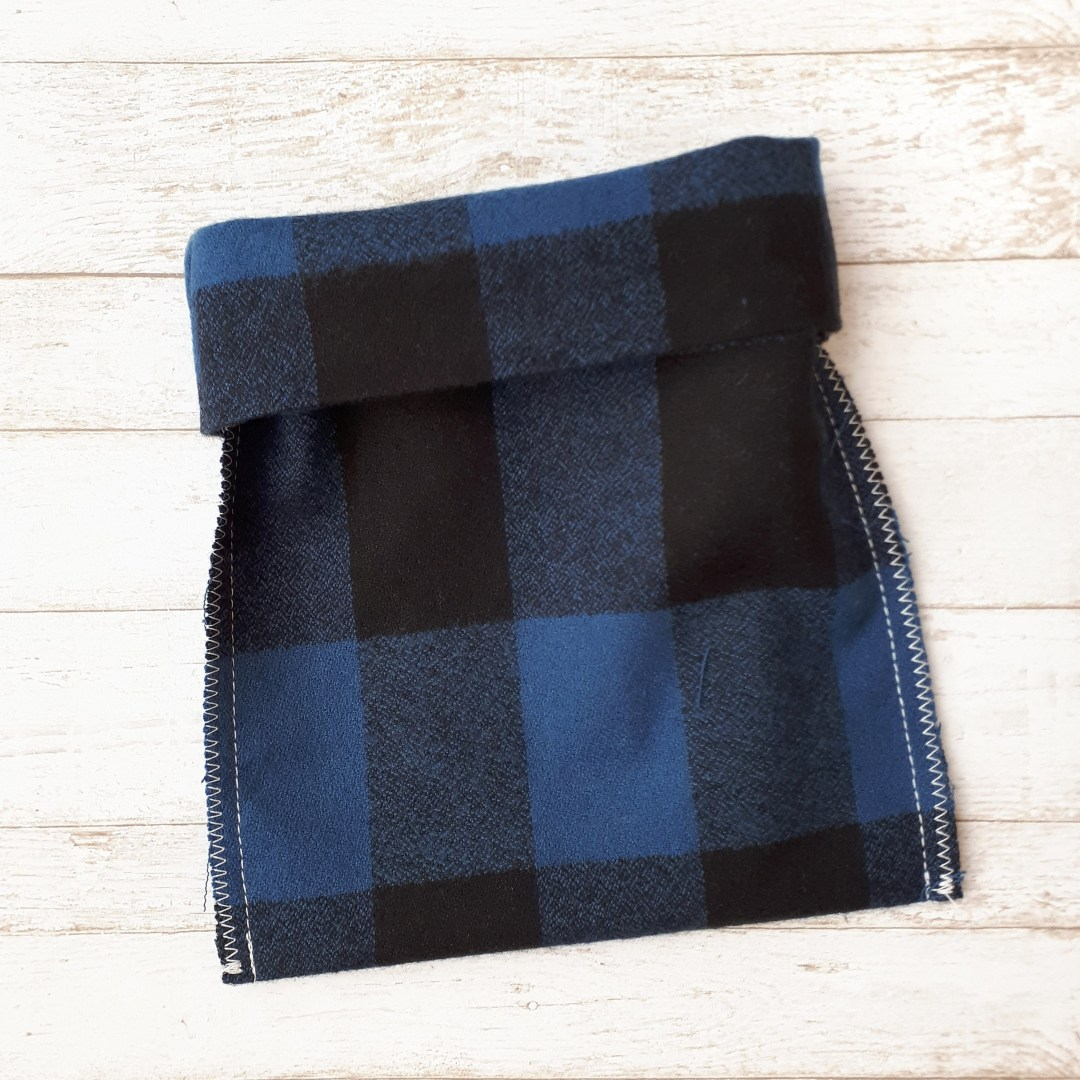 fold down the top of your reusable fabric gift bag