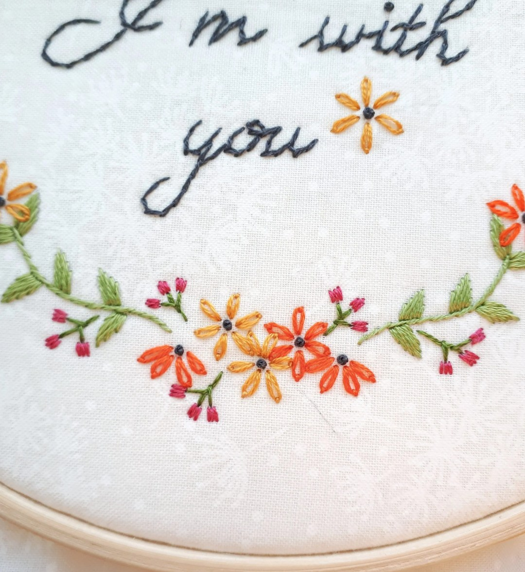 Use a french knot and a lazy daisy stitch to create beautiful black eyed susan flowers!