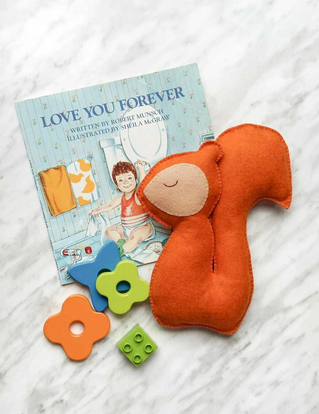 Stuffed animal pattern and tutorial. Make this super cute DIY felt squirrel plushie in an afternoon.