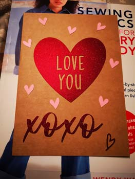 Card made with kraft cardstock, burgundy glitter card and pink card. Showing hearts and kisses with the words love you