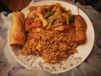 Plate full of Chicken with Ginger and Spring Onion, Fried rice, Spring roll and Chicken satay skewer