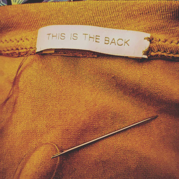 Hand Sewing A Kylie And The Machine Label That Says This Is The Back Into Back Of yellow Blouse