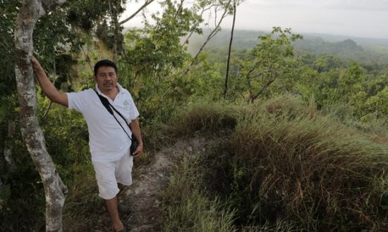 Damian Gomez on top of a lost pyramid in Yucatan. (Photo: Kevin Rushby for the Guardian)