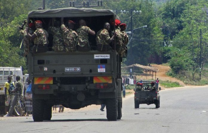 UPDATE 2-Mozambique army condemns horrifying shooting of