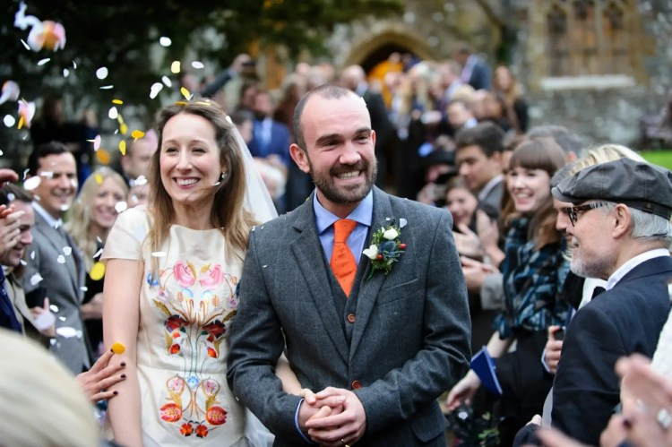 Jesssie & Christian, Wedding at Huntsham Court, Bride and Groom, Amazing wedding dress, colourful wedding dress, the zoots, orange tie,