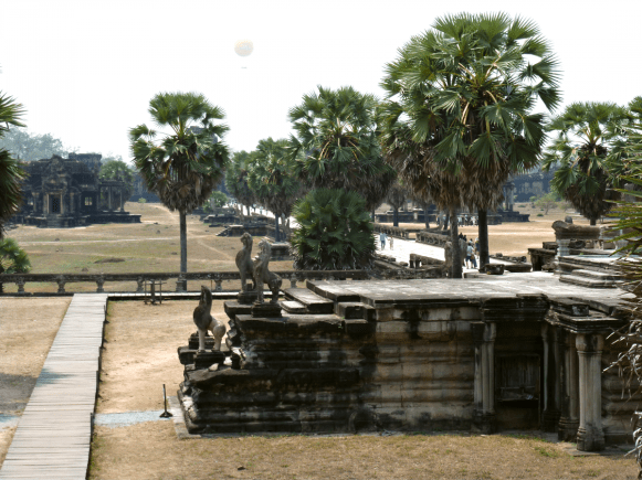 The path to Angkor Wat, with one of its libraries in the background.