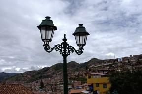A lamppost set against the Cusco's skyline.