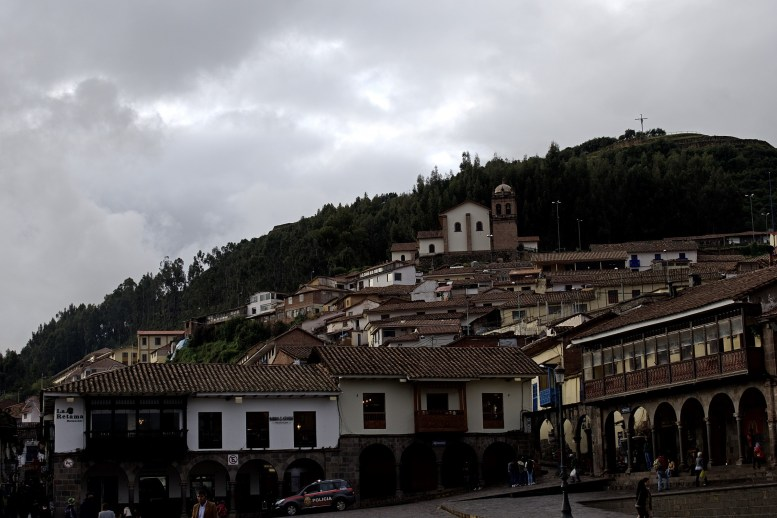 The cross of San Cristobal Church in the distance.