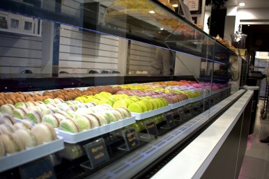 A macaron shop with flavors that range from strawberry to salmon.