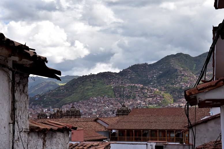 A view of some neighborhoods climbing the slopes around Cusco.