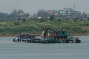 Transporting sand by barges