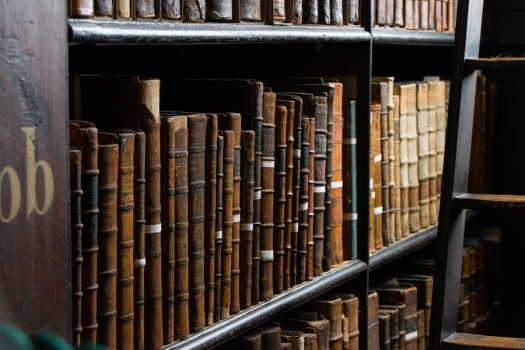 Old books on a library shelf