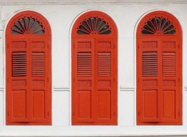 Doors on a classic 2-storey shop house in Singapore.