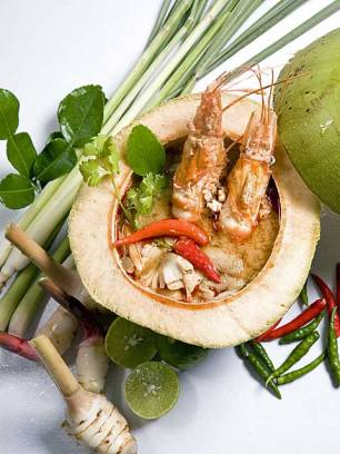 "Famous Thai soup ""Tom Yam Gung"" with herbs."