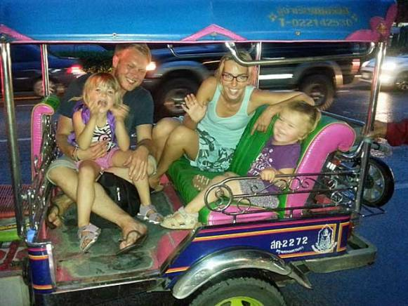 The team from ants-in-our-pants.com gathered in a tuk-tuk in Thailand.