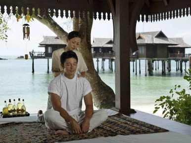 Getting a Thai massage at Pangkor Laut Reosrt, Malaysia.