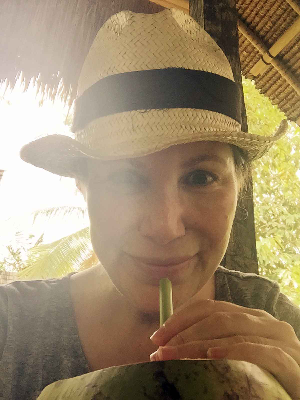 Karin is detoxing on Bali, here sipping on fresh coconut.