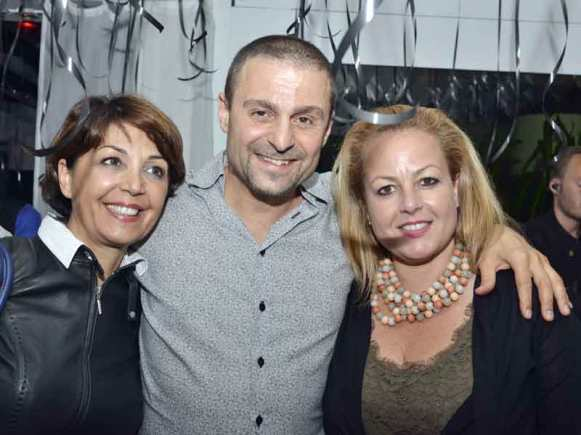 Greg Peter Patrikios, the founder of CIOOA, surrounded by 2 ladies.