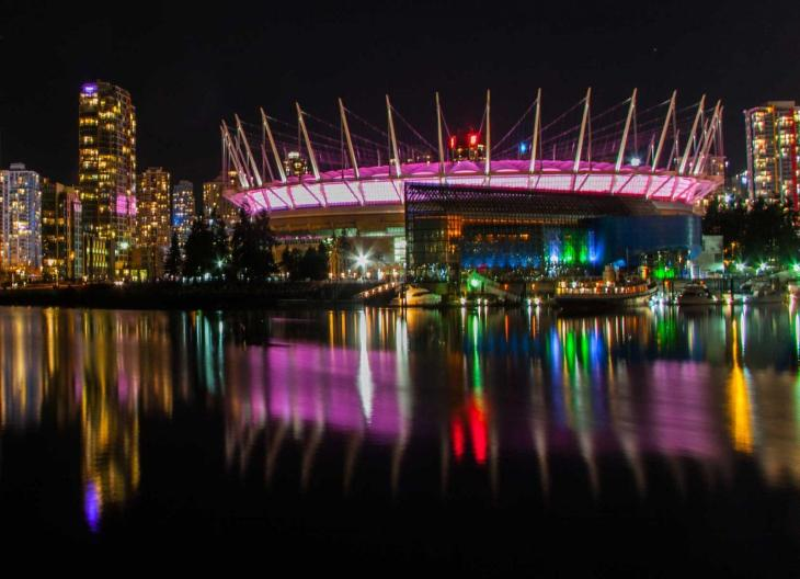 Vancouver skyline at night with BC Place to the right.