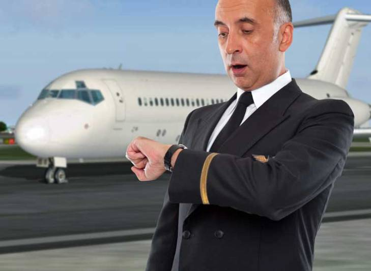 MD-80 pilot looking at his watch. In a hurry?