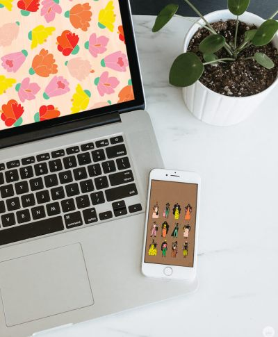 two of our August Wallpapers on an iphone and laptop, laying next to a potted plant on a table | thinkmakeshareblog.com