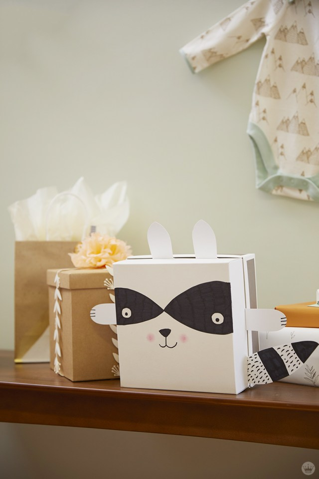 Gift wrapped using a free downloadable baby shower idea: Raccoon bandit