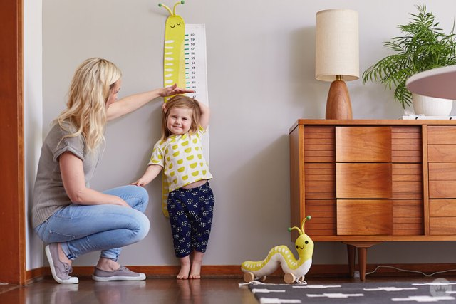 Hallmark Artist Amber G measures daughter. Hallmark Baby Cute Critters collection