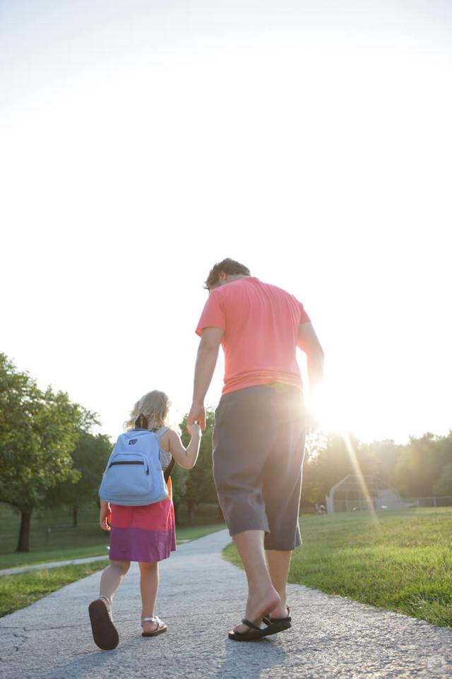 Back-to-school picture ideas: Father and daughter holding hands