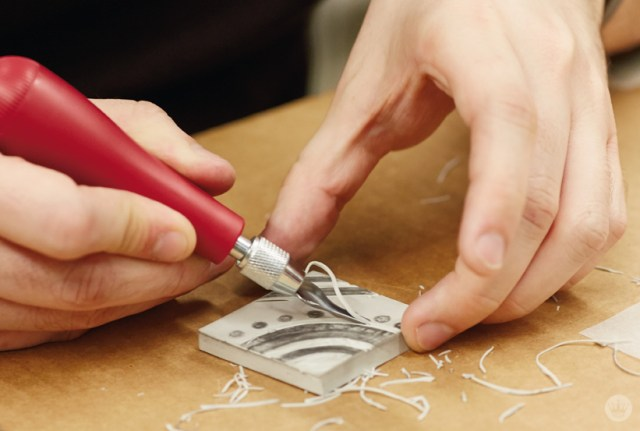 Cutting a linoleum block in a Hallmark block printing basics workshop