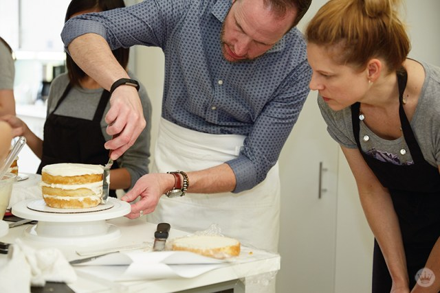 Bernard S. demonstrates a technique for decorating a naked cake