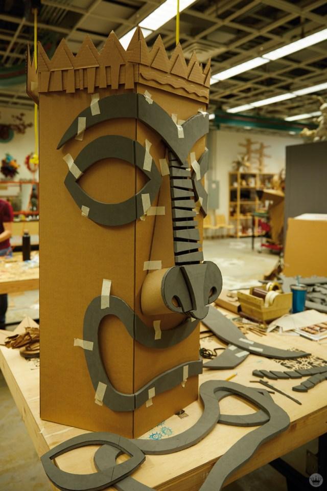 Hallmark artists explore cardboard Halloween costume ideas. Tiki form takes shape.