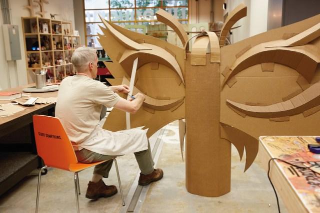Hallmark artists explore cardboard Halloween costume ideas. Ken S works on his moth.