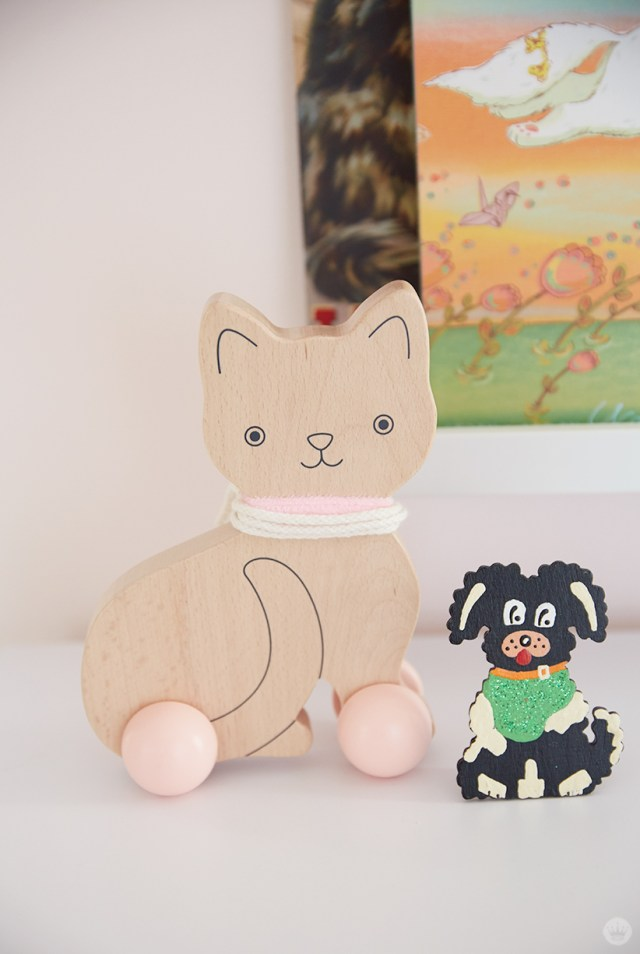 Wooden cat and dog toys in a children's room.